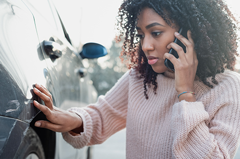 Woman on the phone reporting an accident