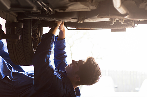 Mechanic working under vehicle