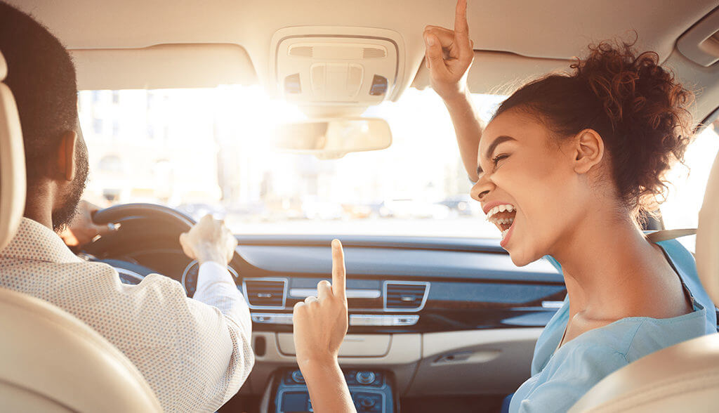 Couple dancing in car
