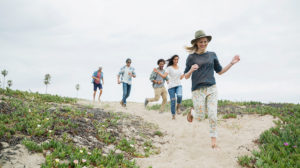 group-of-friends-running-on-beach