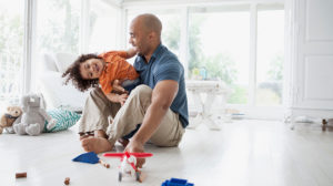 dad-and-daughter-toys-in-living-room