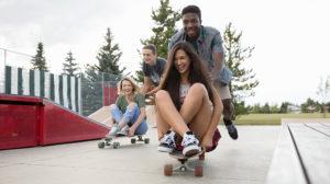 friends riding skateboards together
