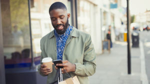young-man-shopping-using-cell-phone