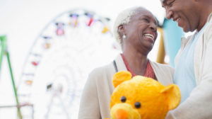 enior-couple-smiling-at-the-fair