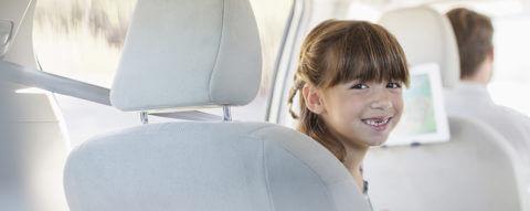 daughter-smiles-in-car-back-seat