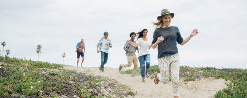 group-of-friends-running-on-beach