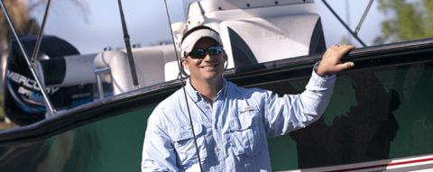 man-near-fishing-boat