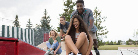 young-friends-playing-on-skateboards