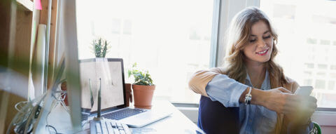 young-woman-office-electronic-devices