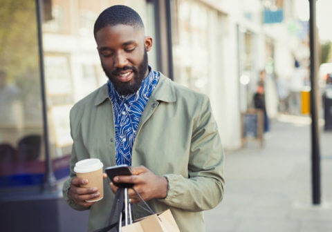 Image of a man checking his phone