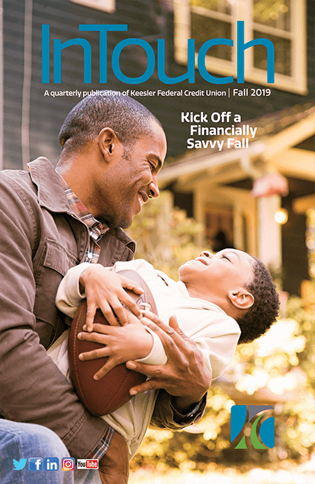2019 Fall InTouch cover, holding son with football