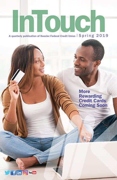 Spring 2019 cover, couple holding credit card in front of computer