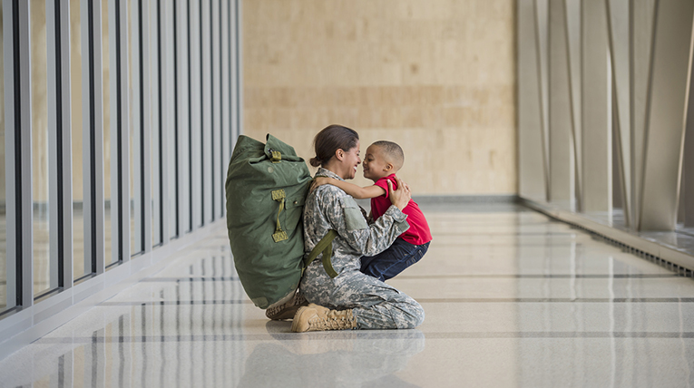 Image of an active duty mother greeting her chid
