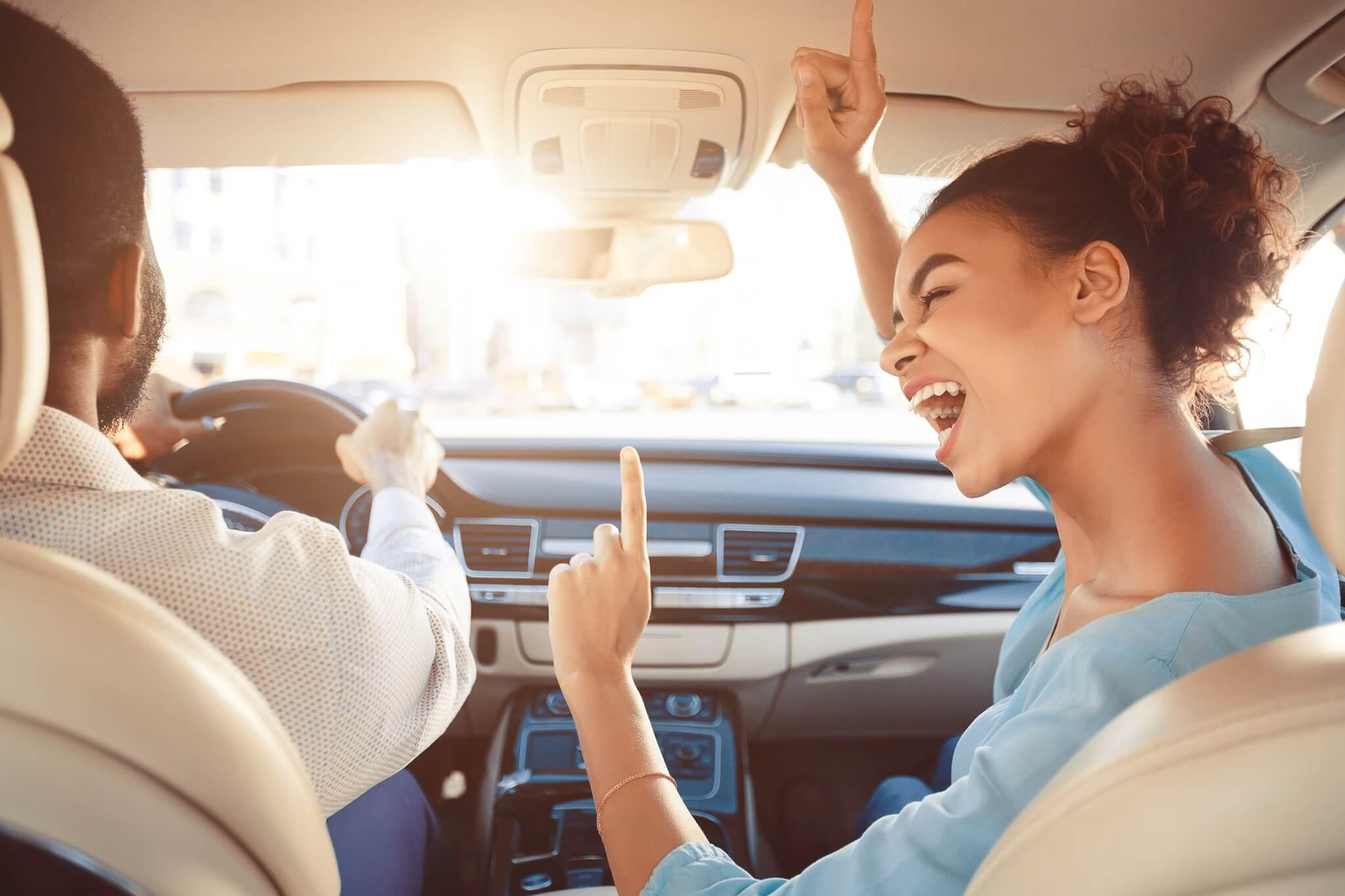 girl singing in car
