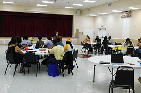 Team members meeting at tables