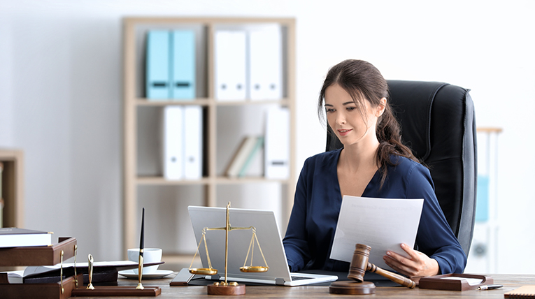 lawyer working on computer at desk