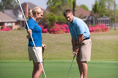 Image of couple on a golf course